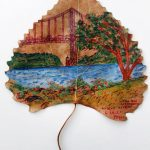 a leaf with a painting of the George Washington Bridge by the Hudson River